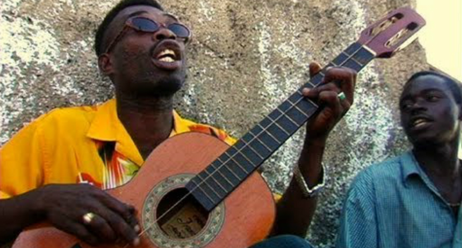 "Jamaican Brushy One String Performs ""Chicken In The Corn"" On One String Guitar 4"