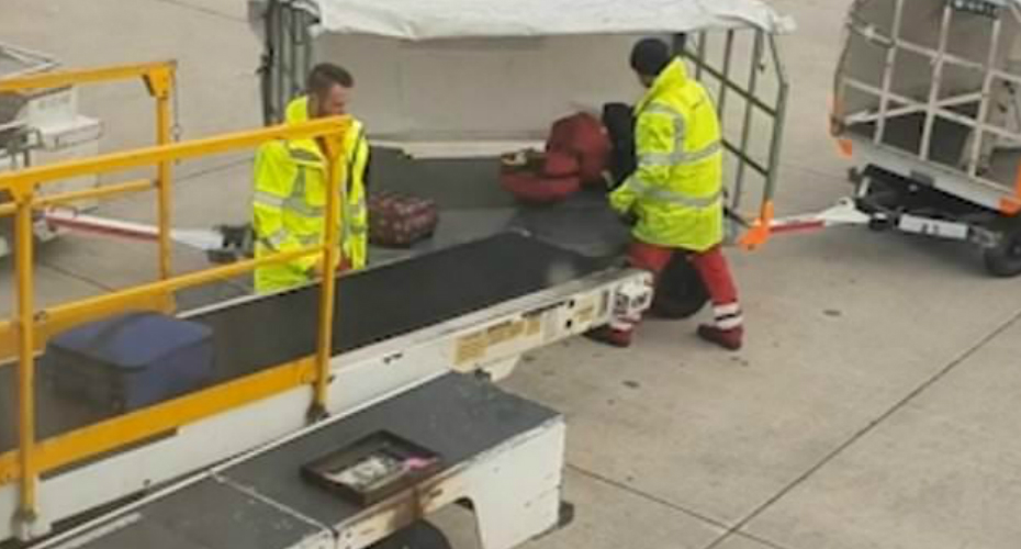 Manchester Airport Staff Carelessly Throw Luggage Onto Carrier 1