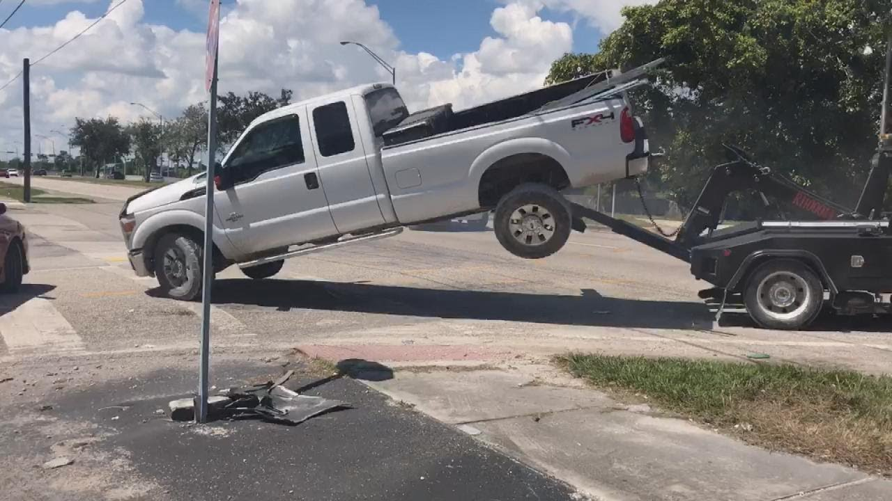 Man Tries to Drive Away in Truck as It's Being Towed 3