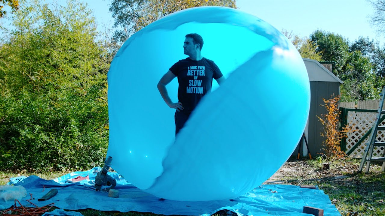 These Guys Get Inside a Giant Balloon, Burst It And Film The Results In Slow Motion 8