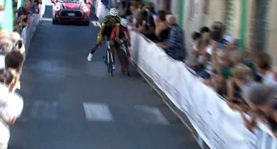Two Cyclists Barge Into Each Other In Desperate Race Battle And End Up Crashing Over The Finish Line 9