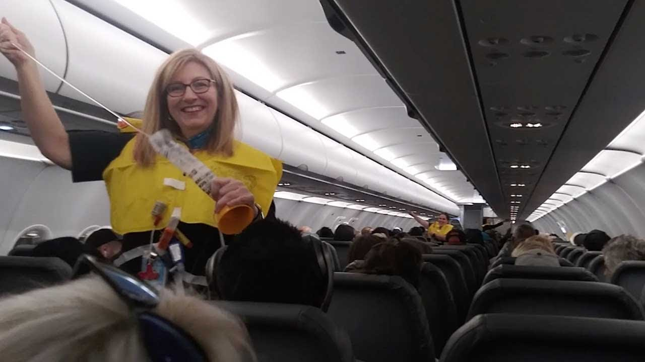 World's Funniest Flight Attendant Leaves Passengers In Hysterics 5