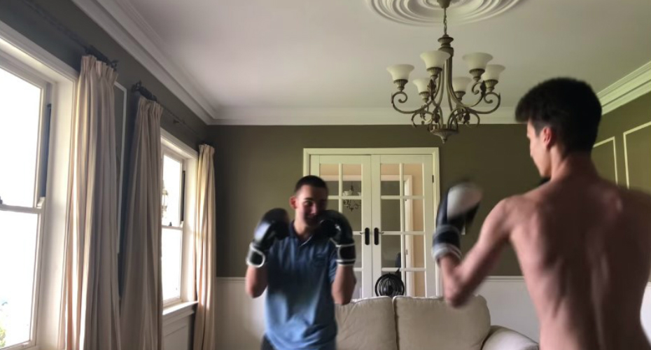 Amateur Boxer Accidentally Sends His Friend Flying Through His Living Room Window Head-First 3