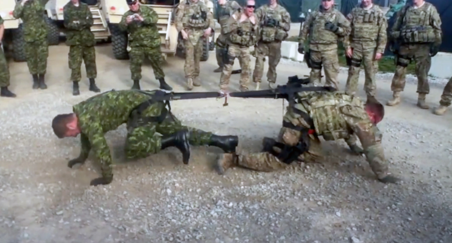 A Canadian And American Soldier Engage In a Friendly One-On-One Game Of Tug Of War 4
