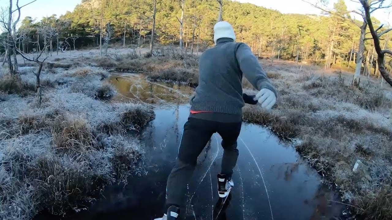 Daring Ice Skater Gliding Down Frozen River 8