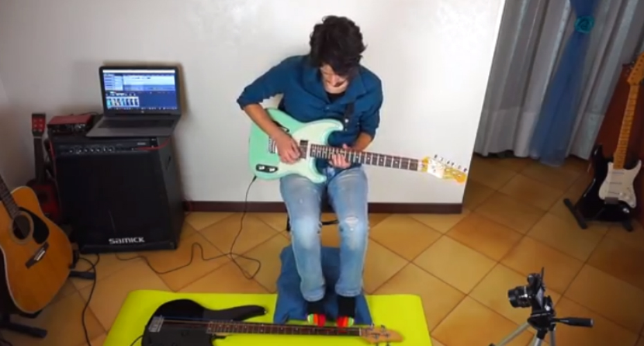 Musician In Toe Socks Plays A Walking Bass Line With His Feet While Playing A Mean Guitar With His Hands 2