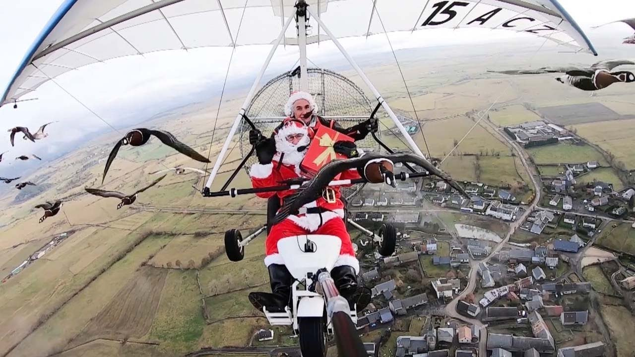 Shocked Santa Joined By Flock Of Geese While Flying On Microlight 8