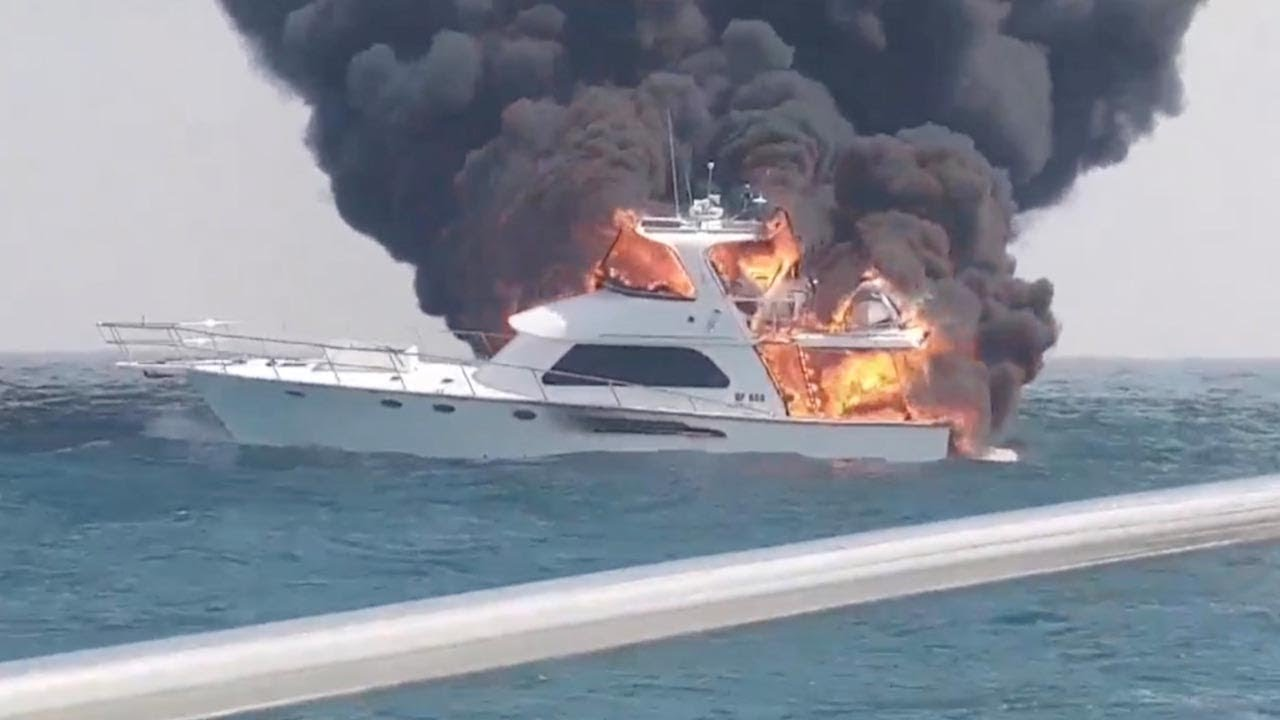 Family Rescued After Their Boat Bursts Into Flames 2