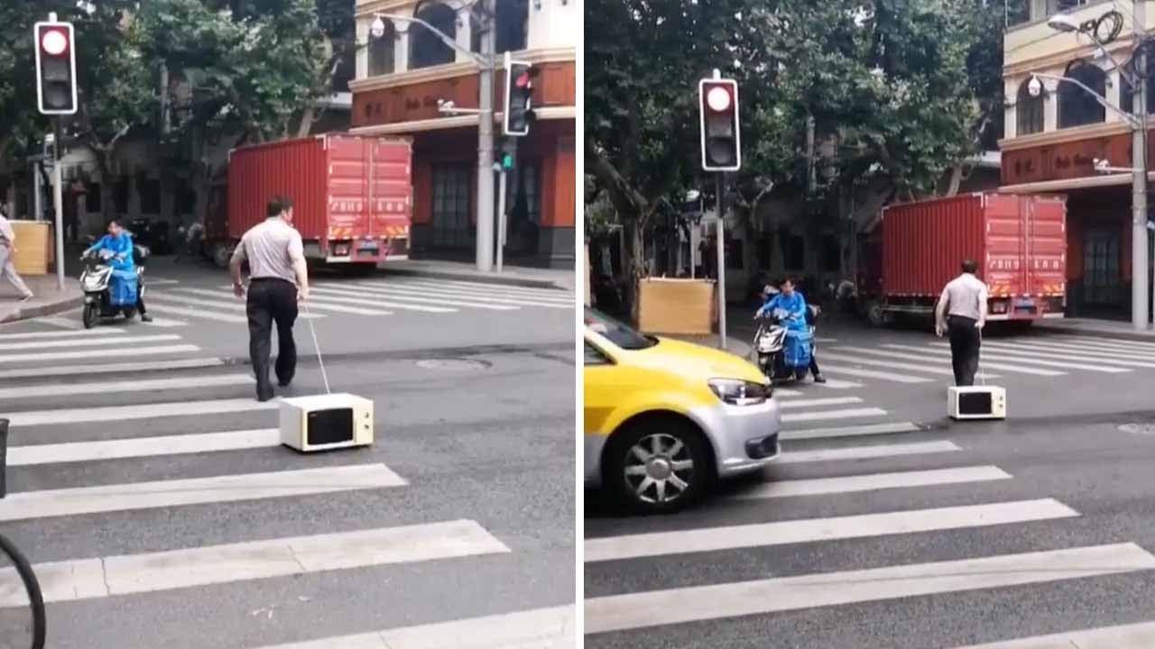 Man Walks Microwave Across Street 5