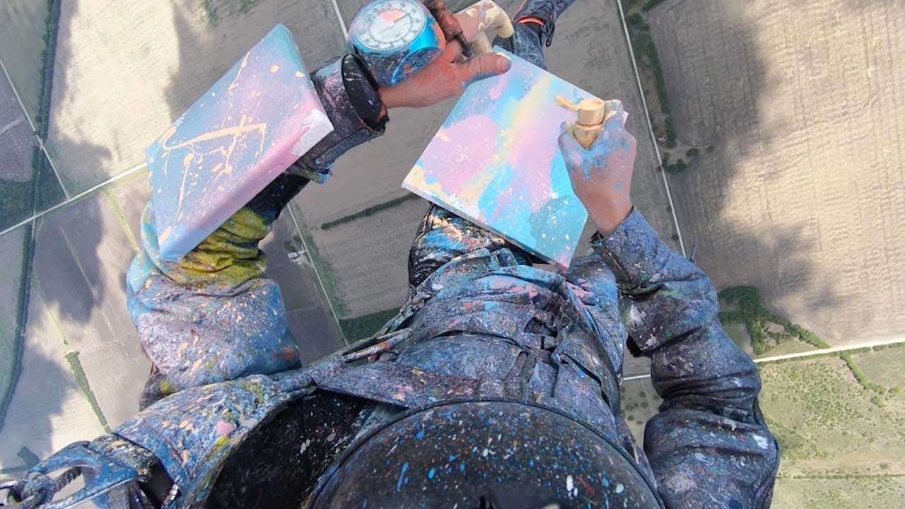 Artistic Daredevil Manages To Paint While Skydiving 7