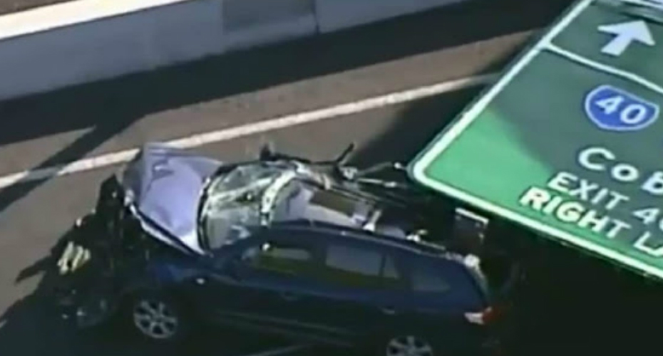 Freeway Sign Falls And Crushes Car, Injuring Driver 3